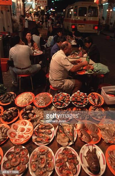 A sea food restaurant at Temple Street Night Market in Kowloon Hong Kong