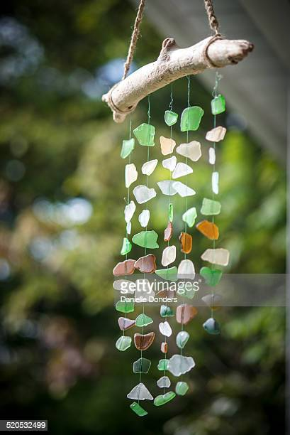 """sea glass driftwood mobile wind chime - """"danielle donders"""" stock pictures, royalty-free photos & images"""