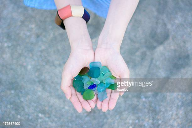 Sea glass in a woman's hand