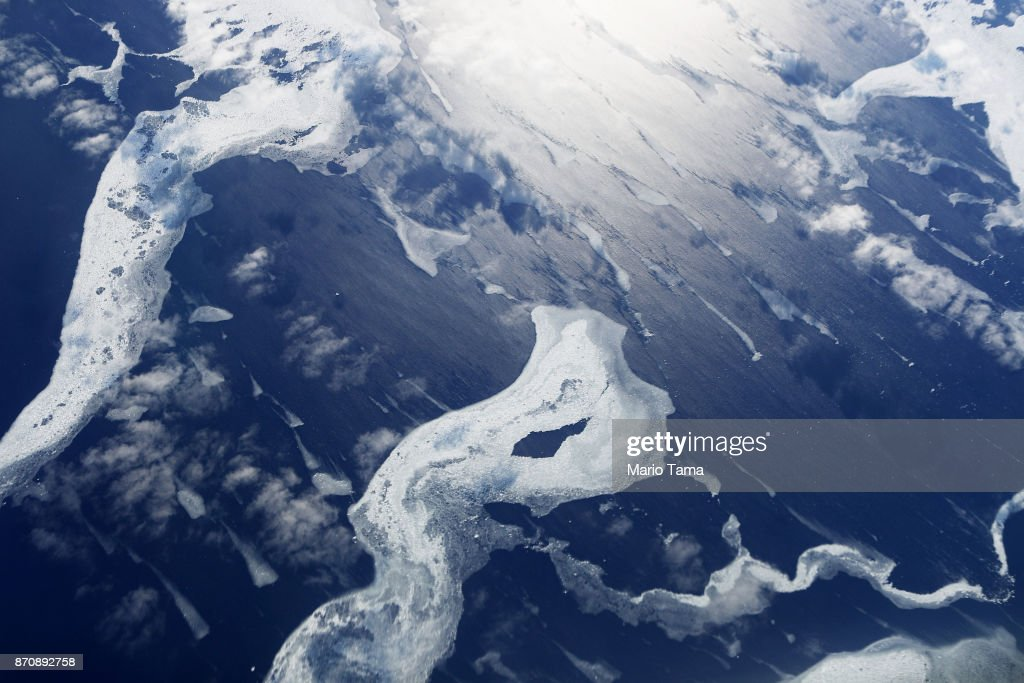 Sea ice as seen from NASA's Operation IceBridge research aircraft in the Antarctic Peninsula region, on November 4, 2017, above Antarctica. NASA's Operation IceBridge has been studying how polar ice has evolved over the past nine years and is currently flying a set of nine-hour research flights over West Antarctica to monitor ice loss aboard a retrofitted 1966 Lockheed P-3 aircraft. According to NASA, the current mission targets 'sea ice in the Bellingshausen and Weddell seas and glaciers in the Antarctic Peninsula and along the English and Bryan Coasts.' Researchers have used the IceBridge data to observe that the West Antarctic Ice Sheet may be in a state of irreversible decline directly contributing to rising sea levels. The National Climate Assessment, a study produced every 4 years by scientists from 13 federal agencies of the U.S. government, released a stark report November 2 stating that global temperature rise over the past 115 years has been primarily caused by 'human activities, especially emissions of greenhouse gases'.