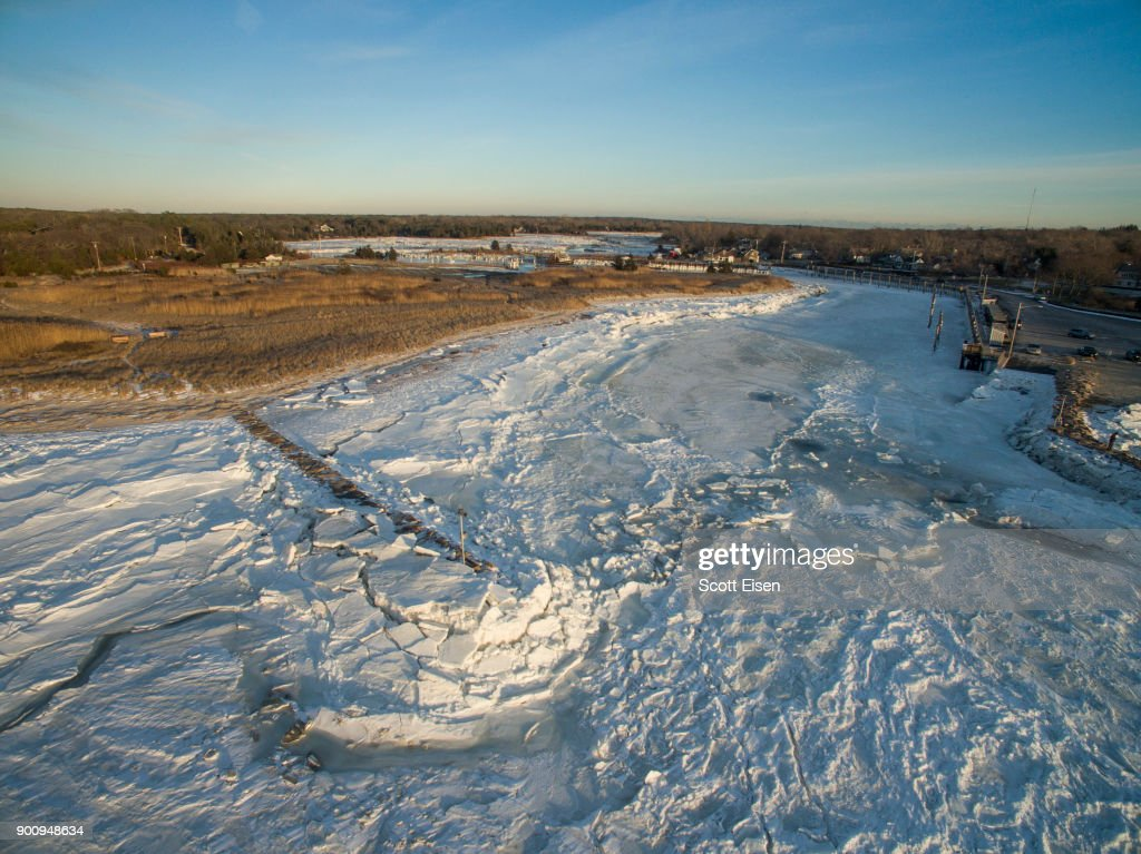 Sea ice covers Cape Cod Bay and the entrance to Rock Harbor on January 3, 2018 in Orleans, Massachusetts. A winter storm is hitting the east coast from Florida to New England bringing snow and frigid temperatures.