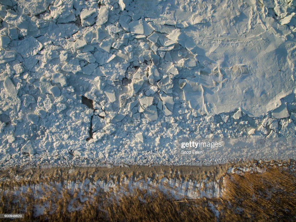 Sea ice covers Cape Cod Bay near Rock Harbor Beach on January 3, 2018 in Orleans, Massachusetts. A winter storm is hitting the east coast from Florida to New England bringing snow and frigid temperatures.