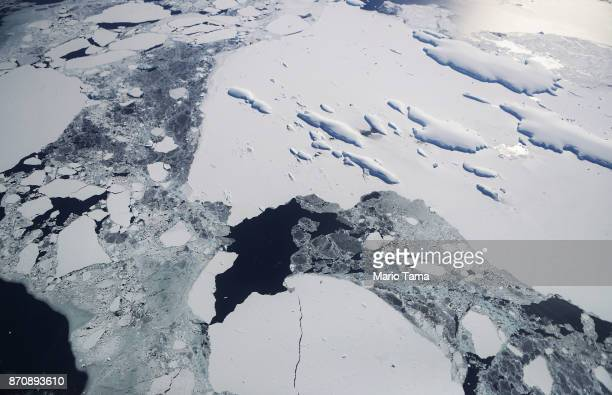 Sea ice floats around a group of islands as seen from NASA's Operation IceBridge research aircraft off the coast of the Antarctic Peninsula region on...