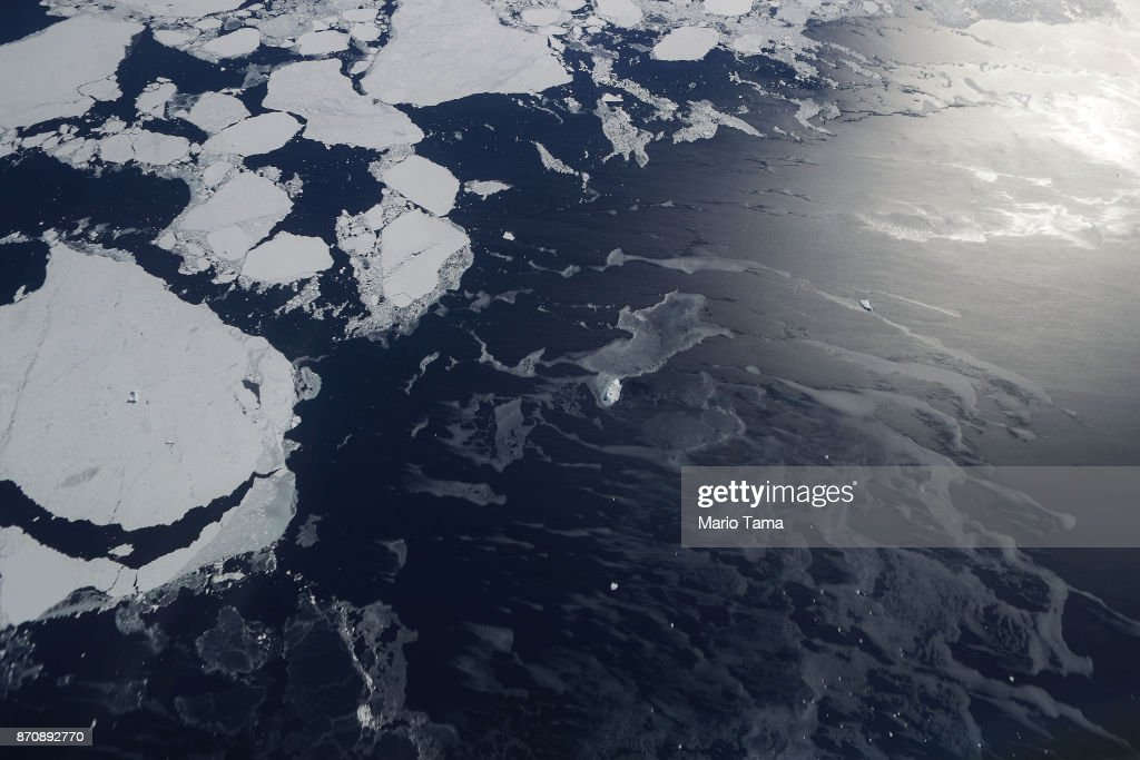 Sea ice is seen from NASA's Operation IceBridge research aircraft in the Antarctic Peninsula region, on November 4, 2017, above Antarctica. NASA's Operation IceBridge has been studying how polar ice has evolved over the past nine years and is currently flying a set of nine-hour research flights over West Antarctica to monitor ice loss aboard a retrofitted 1966 Lockheed P-3 aircraft. According to NASA, the current mission targets 'sea ice in the Bellingshausen and Weddell seas and glaciers in the Antarctic Peninsula and along the English and Bryan Coasts.' Researchers have used the IceBridge data to observe that the West Antarctic Ice Sheet may be in a state of irreversible decline directly contributing to rising sea levels. The National Climate Assessment, a study produced every 4 years by scientists from 13 federal agencies of the U.S. government, released a stark report November 2 stating that global temperature rise over the past 115 years has been primarily caused by 'human activities, especially emissions of greenhouse gases'.