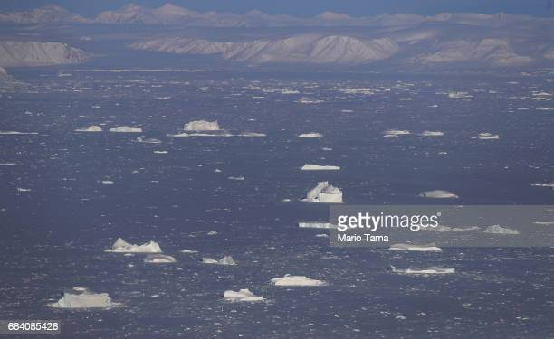 Sea ice is seen from NASA's Operation IceBridge research aircraft on March 30 2017 above Ellesmere Island Canada The ice fields of Ellesmere Island...