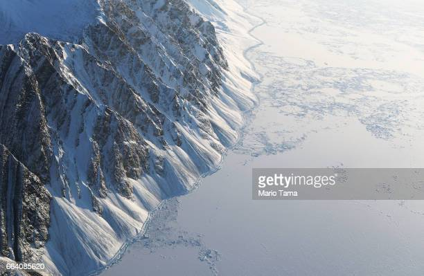 Sea ice is seen from NASA's Operation IceBridge research aircraft on March 29 2017 above Ellesmere Island Canada The ice fields of Ellesmere Island...