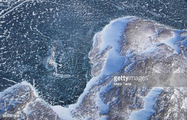 Sea ice meets land as seen from NASA's Operation IceBridge research aircraft along the Upper Baffin Bay coast on March 27 2017 above Greenland...