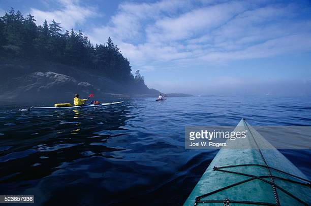 sea kayakers in the strait of juan de fuca - cape flattery stock photos and pictures