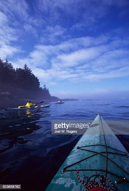 sea kayakers near cape flattery - cape flattery stock photos and pictures