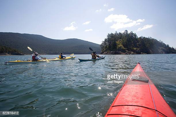 sea kayakers near strawberry island - joel rogers stock pictures, royalty-free photos & images