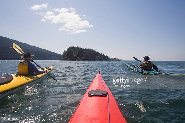 sea kayakers paddling on rosario strait - joel rogers stock pictures, royalty-free photos & images