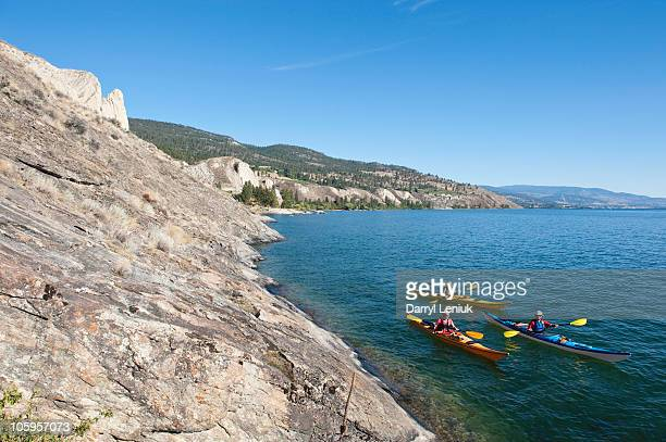 sea kayakers - okanagan valley stock pictures, royalty-free photos & images