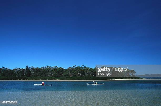 Sea kayaking at the Lagoon on Bruny Island in southern Tasmania Surrounded by ocean and containing vast areas of spectacular wilderness Tasmania is...