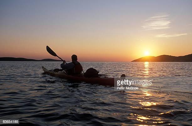 Sea kayaking in Croatia at sunset.