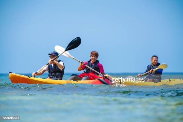 sea kayaking in okinawa - tdub_video stock pictures, royalty-free photos & images
