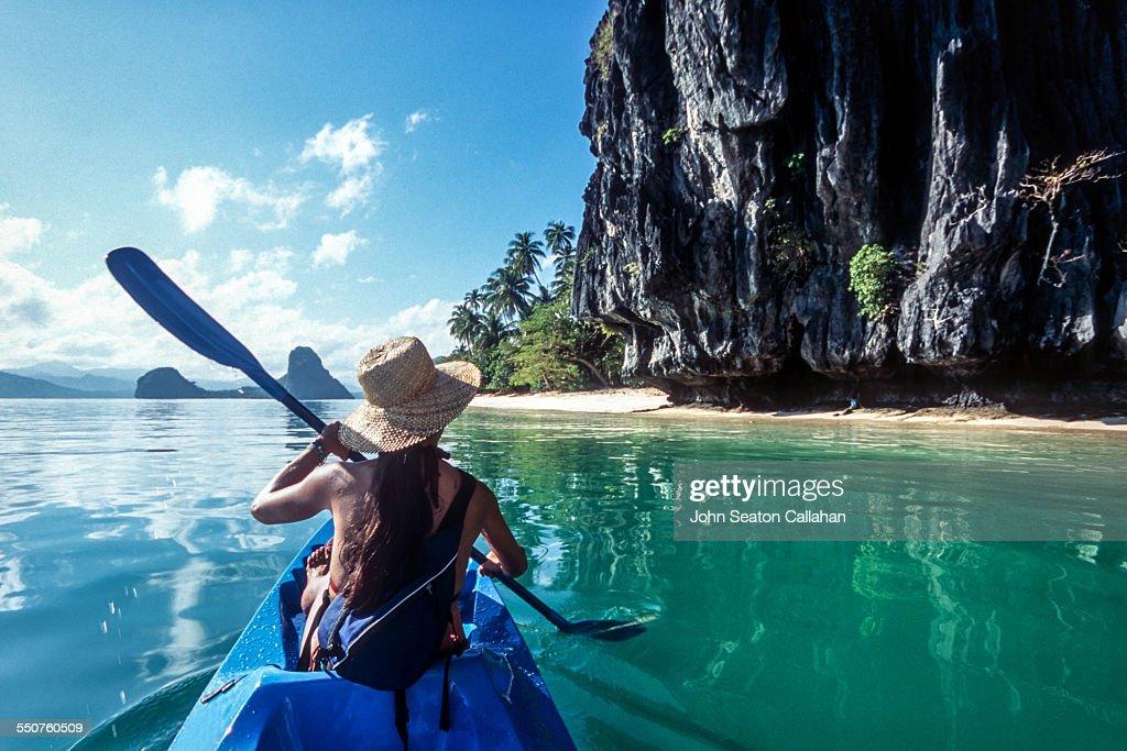 The Philippines, Palawan, El Nido, sea kayaking in Bacuit Bay.