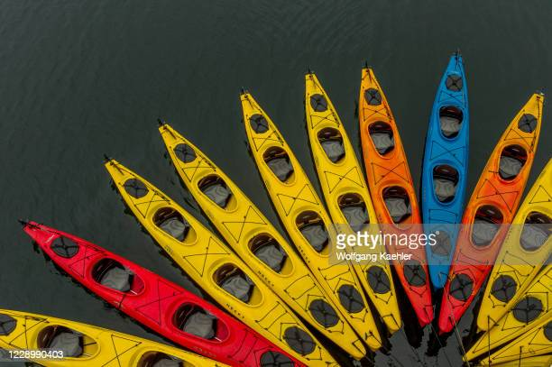 Sea kayaks next to cruise ship Safari Endeavour at Port Althorpe, Chichagof Island, Southeast Alaska, USA.