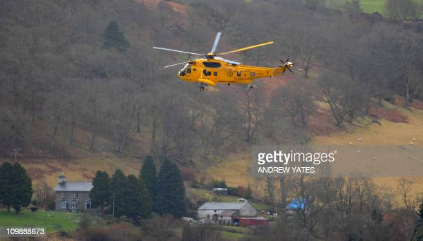 A Sea king helicopter flies above Bala Lake north Wales during a simulated flood rescue on March 9 2011 Representatives from the three fire and...