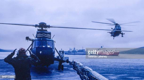 Sea King helicopters landing troops on deck during the Falklands War 1982 MS Baltic Ferry in background