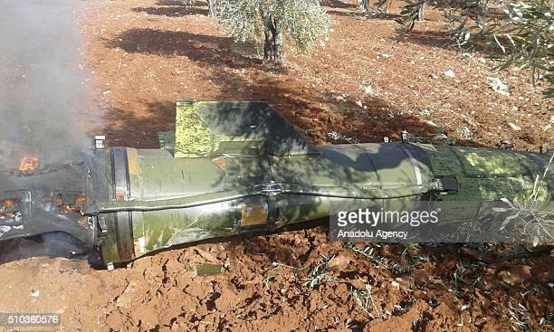 A sea launched ballistic missile is seen unexploded on the soil at a olive grove after Russian warships anchored near Latakia Port launched 8...