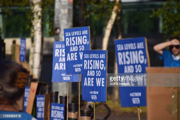 Sea Levels Are Rising, And So Are We placards seen during the G7 protest. Extinction Rebellion activists gathered outside Tate Modern as part of the...