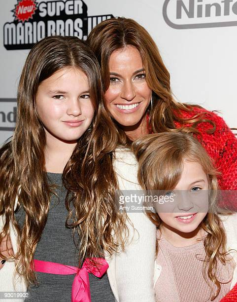 Sea Louise ''Real Housewives'' star Kelly Bensimon and Tadeus Ann attend the 25 years of Mario celebration at the Nintendo World Store on November 12...