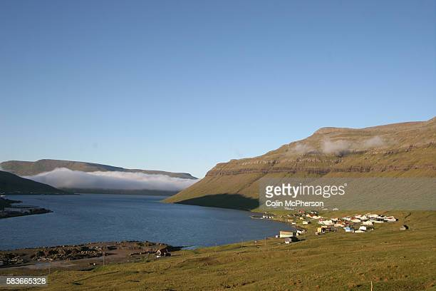 Sea mist in aflord at the village of Kollafjrdur on the island of Streymoy close to the Faroe Islands' capital Trshavn The Faroes a group of 18...