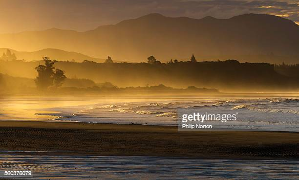 sea mist sunset - nelson city new zealand stock pictures, royalty-free photos & images
