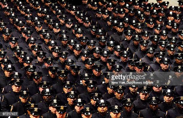 A sea of blue fills Madison Square Garden as 1359 new police officers attend an NYPD graduation ceremony This graduating class one of the most...