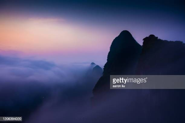 a sea of clouds at dawn - liu he stock pictures, royalty-free photos & images