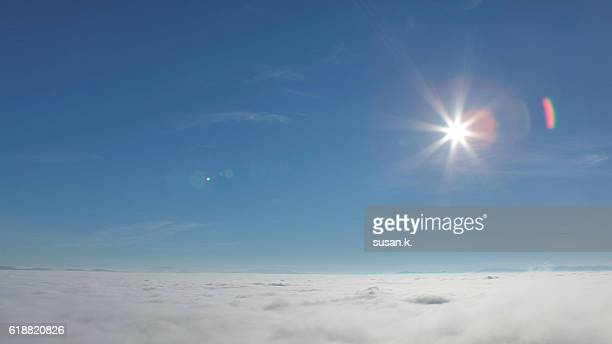 Sea of fog on clear blue sky and bright sunlight
