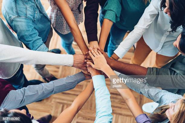 sea of hands - teamwork stock pictures, royalty-free photos & images