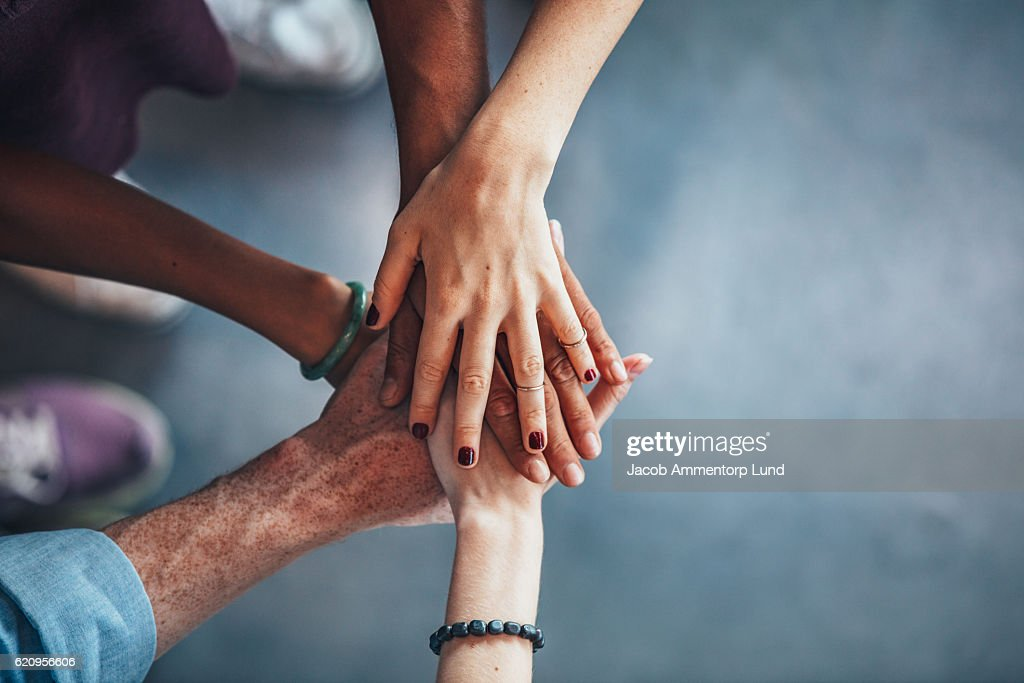 Sea of hands showing unity and teamwork : Stock Photo