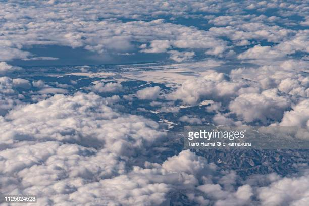 Sea of Japan and Katagami city in Akita prefecture in Japan daytime aerial view from airplane