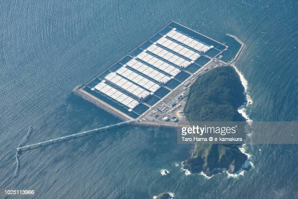 sea of japan and shirashima (oshima) island in kitakyushu city in fukuoka prefecture in japan daytime aerial view from airplane - vaseline stock pictures, royalty-free photos & images