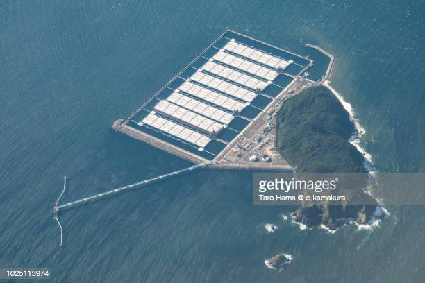 sea of japan and shirashima (oshima) island in kitakyushu city in fukuoka prefecture in japan daytime aerial view from airplane - vaseline stockfoto's en -beelden
