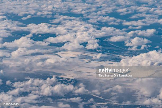 Sea of Japan, Oga city and Ogata village in Akita prefecture in Japan daytime aerial view from airplane