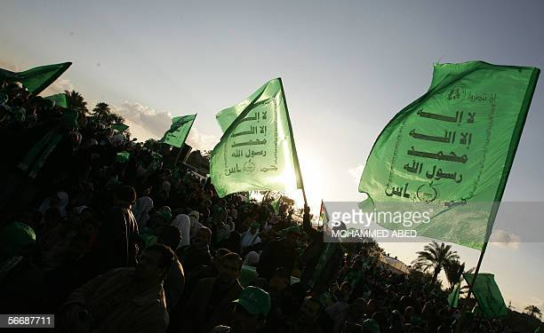 A sea of Palestinain Hamas supporters wave the Islamist group's green flags during a celebration rally in the southern Gaza Strip refugee camp of...