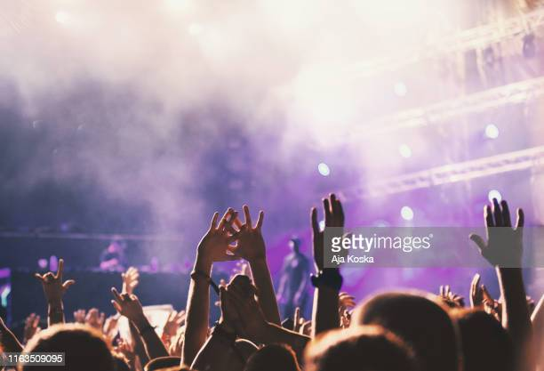 sea of raised hands at music festival. - live event stock pictures, royalty-free photos & images
