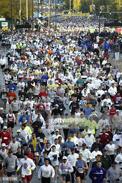 A sea of runners race through Grant Park in downtown Chicago at the start of the 25th annual Chicago Marathon 13 October 2002 37500 runners...