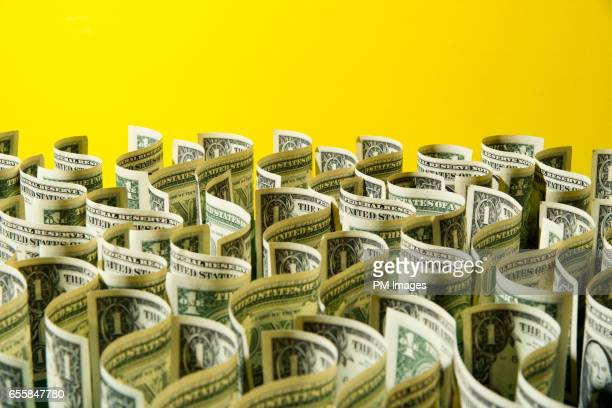 sea of us 1 dollar bills on yellow background - american one dollar bill stock pictures, royalty-free photos & images