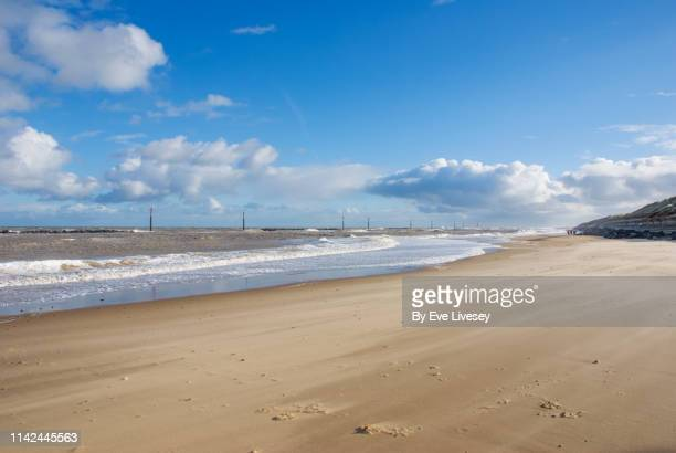 sea palling beach on a windy winters day - cumulus stock pictures, royalty-free photos & images