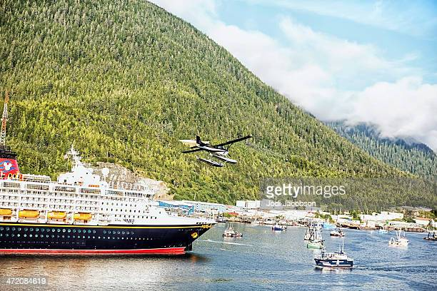 Sea plane flying over cruise ship docked in Ketchikan, Alaska