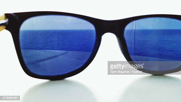 Sea Reflecting On Sunglasses At Table Outdoors