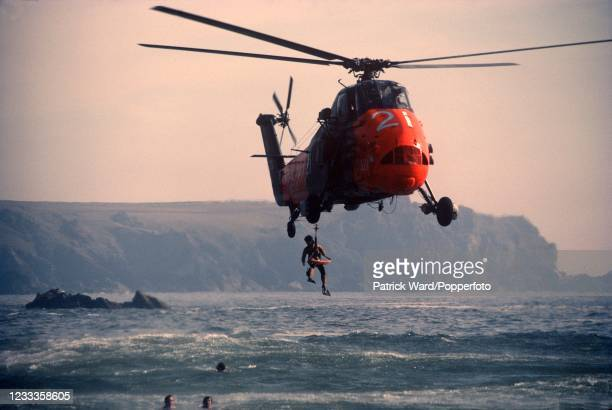 Sea rescue by Royal Navy helicopter at Bethrudan Steps near Newquay in Cornwall, circa June 1985.