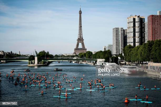 TOPSHOT Sea rescuers paddle during a nautical parade on the Seine river in Paris on June 24 2018 a day after the national sea rescuers' day