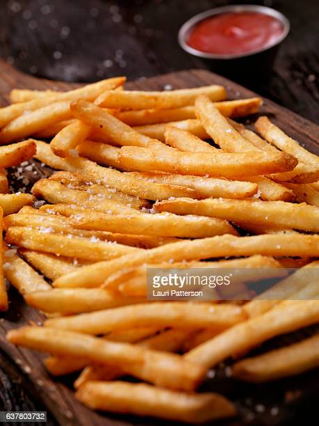 sea salt french fries with ketchup - french fries stock pictures, royalty-free photos & images