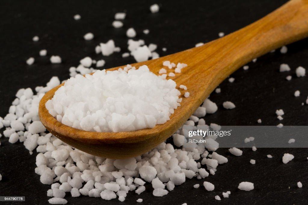 Sea salt in wooden spoon : Stock Photo