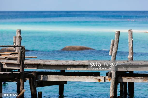 sea, sand, sun and the wooden bridge - surat thani province stock pictures, royalty-free photos & images