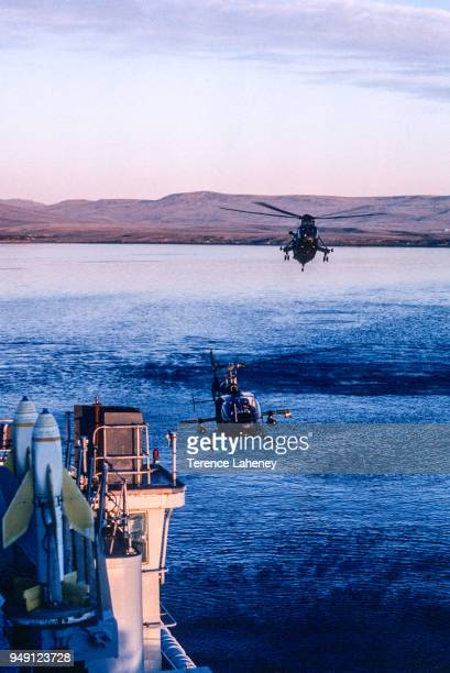 Sea scout helicopter landing onto HMS Fearless with armed Seacat missiles during the second day of the conflict Falklands War 1982